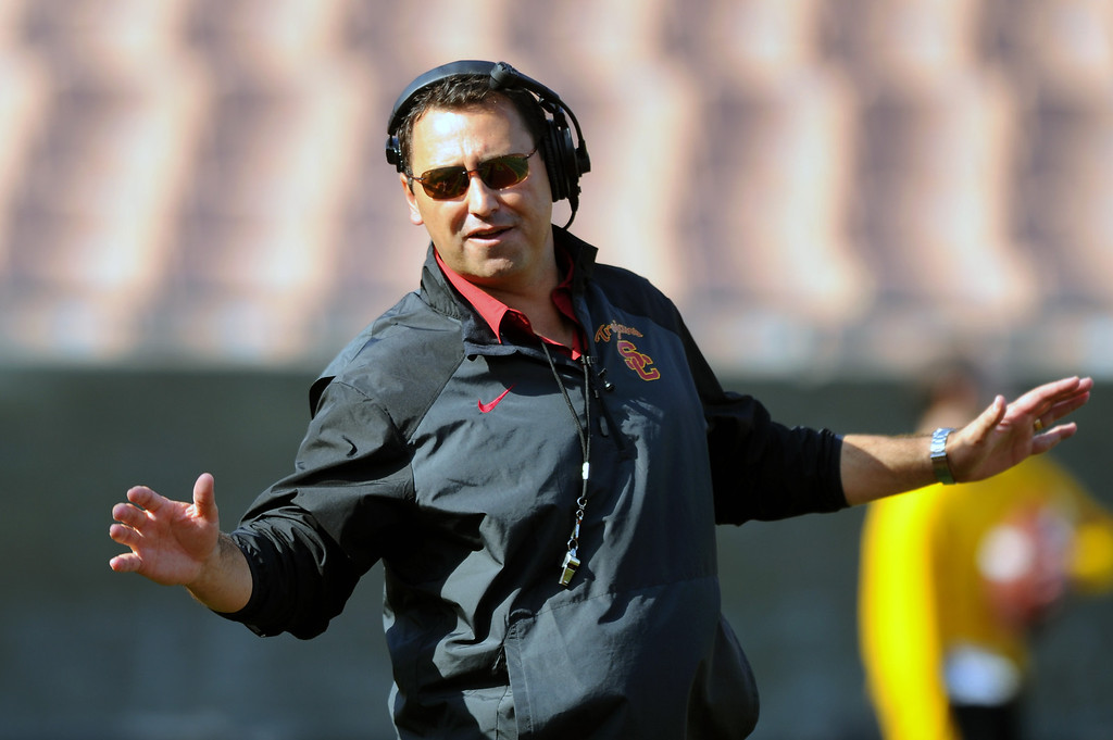 . USC head coach Steve Sarkisian has fun during their spring game, Saturday, April 19, 2014, at the Coliseum. (Photo by Michael Owen Baker/L.A. Daily News)
