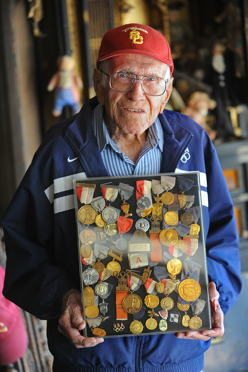 . Louis Zamperini, 94, at his Hollywood home with various track medals from his early running matches.  (Photo by Brad Graverson/Daily Breeze) 11-7-10