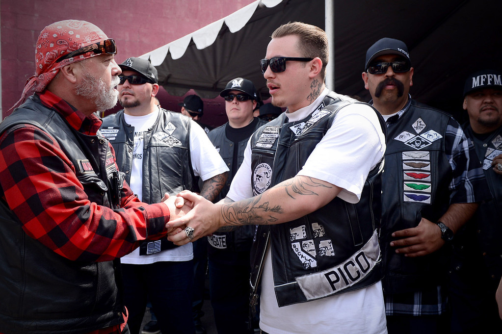 ". Rich ""Hades\"" O\'Henley, of Orange County\'s Devils Rejects, left, greets local Mongols as they rally Saturday, March 29, 2013 at The House Lounge in Maywood in support of the Mongols who are facing a federal trial seeking to take away their trademark patch. (Photo by Sarah Reingewirtz/Pasadena Star-News)"