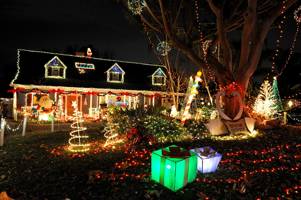 """. Many houses with elaborate holiday displays can be found in the \""""Candy Cane Lane\"""" area of Woodland Hills, CA December 17, 2013.  Candy Cane Lane is located near Lubao Avenue and Oxnard Street and consists of eight square-blocks that is annually transformed into a celebration of lights, figures and artificial snow.(Andy Holzman/Los Angeles Daily News)"""