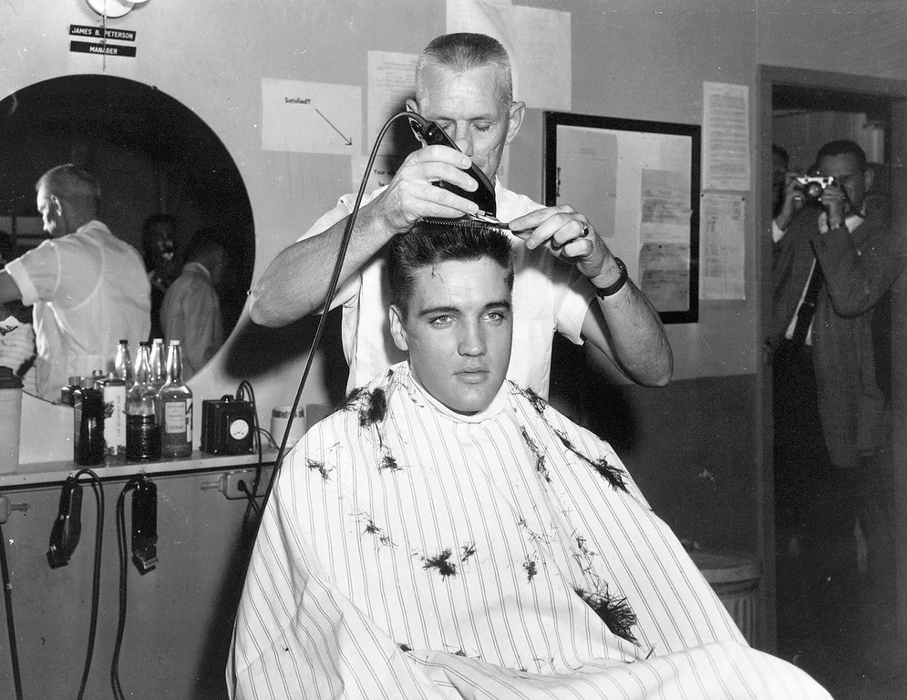 . In this March 1958 file photo, singer Elvis Presley gets his hair cut before entering the Army at Fort Chaffee in Barling, Ark. According the the U.S. Army, Presley entered the service March 24, 1958, at Fort Chaffee Reception Station. (AP Photo/File)