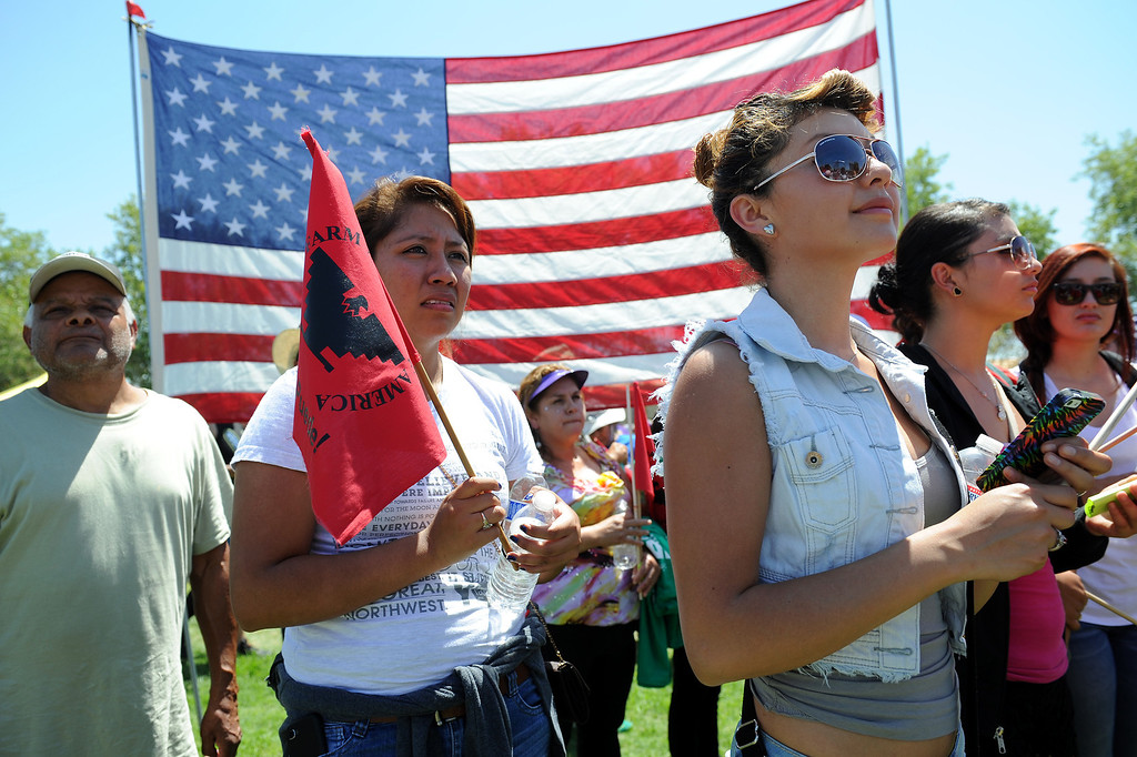 ". People listen to speakers at the ""Caravan for Citizenship\"" rally at Yokuts Park in Bakersfield, Wednesday, August 14, 2013. (Michael Owen Baker/L.A. Daily News)"