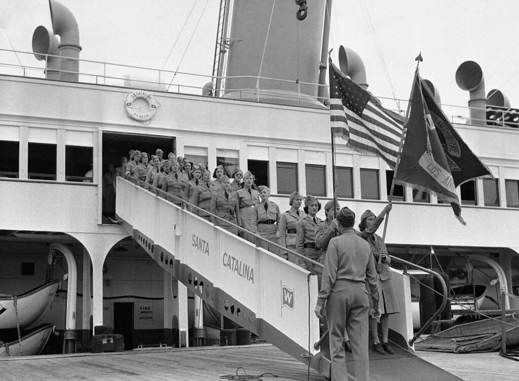. Some 1,000 members of the Women�s Ambulance and Defense Corps of America staged extensive mimic maneuvers at Santa Catalina Island, in a demonstration of technique and training acquired since their organization was formed. One of 27 units disembarking after arrival at Avalon, Calif., July 28, 1941 by steamer. The corps is composed of women volunteers who devote two nights each week to military drills and schooling. (AP Photo/Ed Widdis)