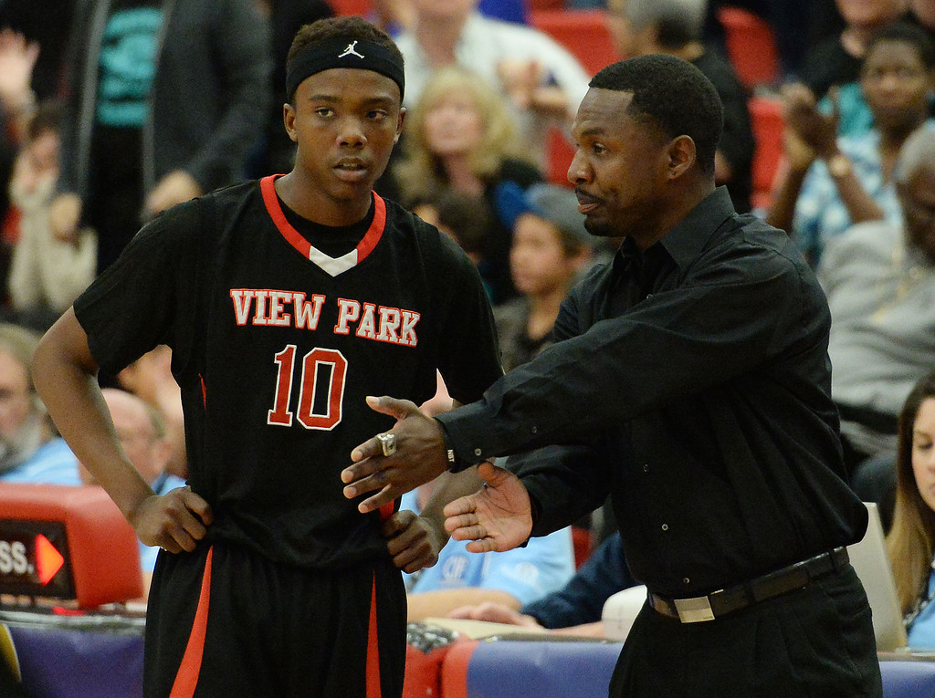 . View Park head coach Ken Henderson talks with Darryl McMillon (C) (10) in the first half of a CIF Southern California Regional Division basketball game at Colony High School in Ontario, Calif., on Saturday, March 22, 2014.  (Keith Birmingham Pasadena Star-News)
