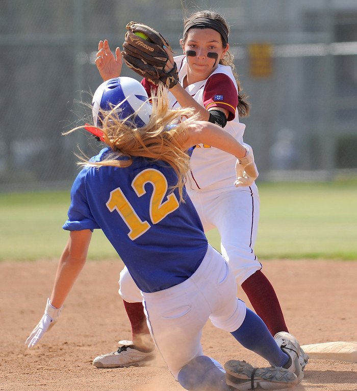 . 05-16-2013-( Daily Breeze Staff Photo by Sean Hiller) Wilson vs. El Toro in the opening round of the CIF-SS D2 playoffs Thursday at Joe Rodgers Field in Long Beach. Wilson\'s Kori Cochran stops El Toro\'s Lauren Hammond in her tracks at second base.