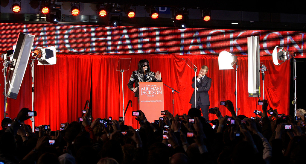 . US singer Michael Jackson announces that he is set to play ten live concerts at the London O2 Arena in July, which he announced at a press conference at the London O2 Arena, Thursday, March 5, 2009.  (AP Photo/Joel Ryan)