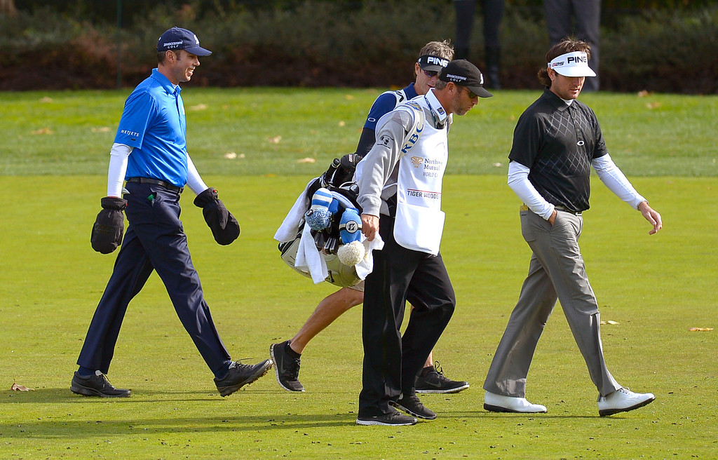 . Matt Kuchar wears a pair of gloves while walking up the fouourth fairway with Bubba Watson during the final round of the Northwestern Mutual World Challenge golf tournament at Sherwood Country Club, Sunday December 8, 2013, in Thousand Oaks, Calif.(Andy Holzman/Los Angeles Daily News)