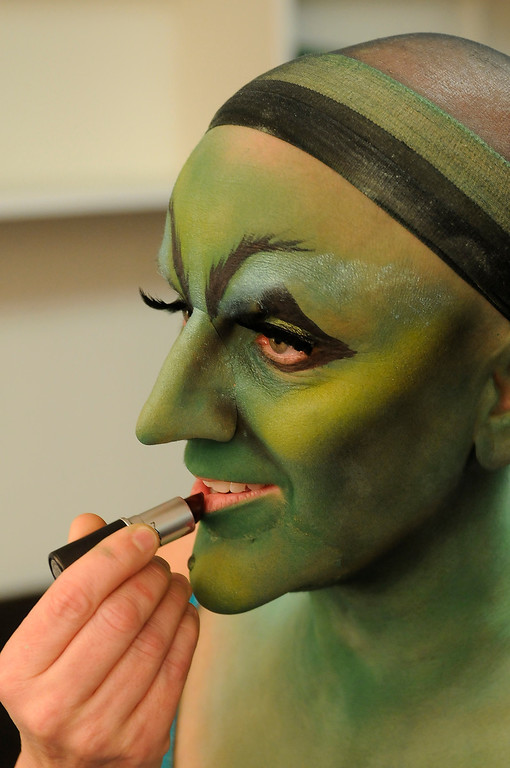 . Long fake eyelashes and lipstick finish off the makeup. Jacquelyn Piro Donovan is transformed into the Wicked Witch by makeup artist Michael King. The Wizard of Oz is being staged at the Pantages Theatre in Hollywood, CA. 9/25/2013. photo by (John McCoy/Los Angeles Daily News)