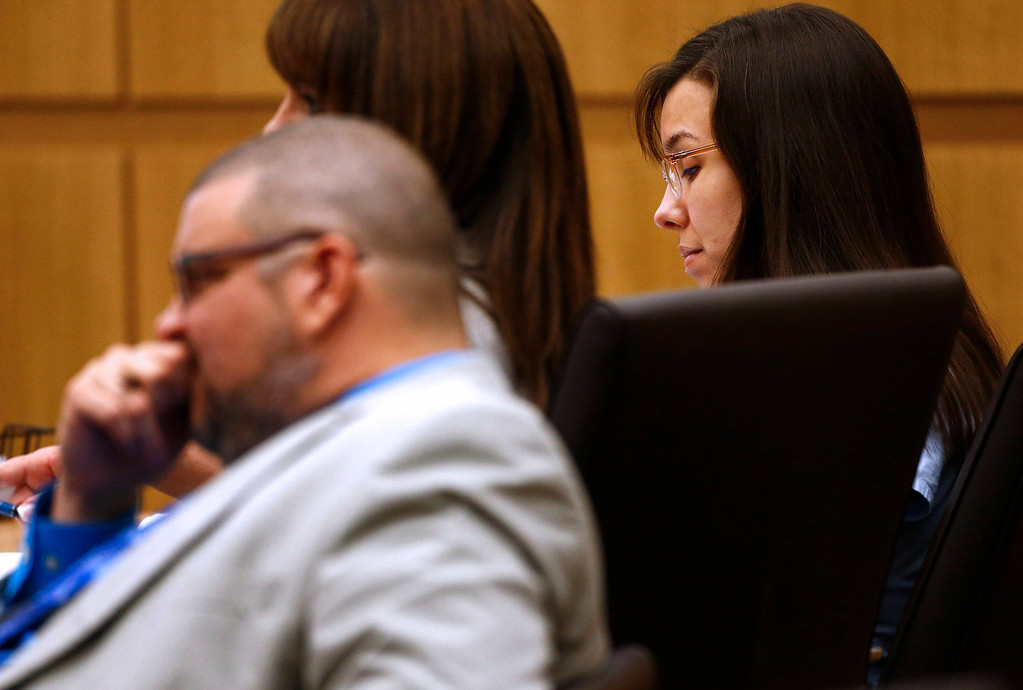 . Defendant Jodi Arias listens to prosecutor Juan Martinez makes his closing arguments during her trial at Maricopa County Superior Court in Phoenix on Thursday, May 2, 2013. Arias is charged with first-degree murder in the stabbing and shooting death of Travis Alexander, 30, in his suburban Phoenix home in June 2008. (The Arizona Republic, Rob Schumacher, Pool)