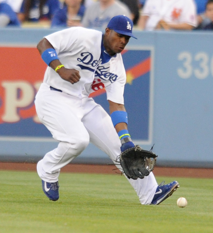 . Yasiel Puig fields a Marlon Byrd single in the 2nd inning. The Dodgers play the New York Mets in a game at Dodger Stadium in Los Angeles, CA. 8/13/2013(John McCoy/LA Daily News)