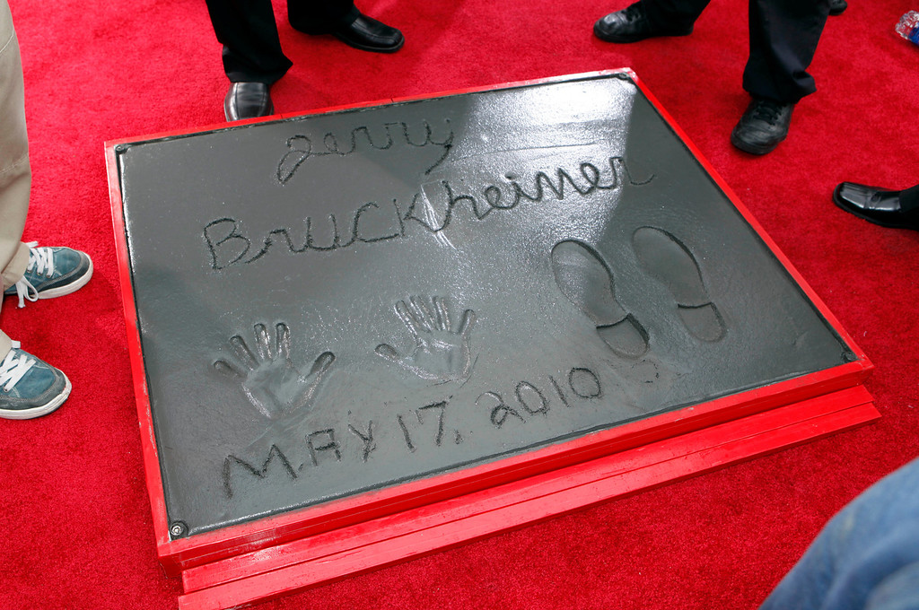 ". Movie and television producer Jerry Bruckheimer adds his hand and footprints to some 200 other celebrity impressions in the forecourt of Grauman\'s Chinese Theatre in the Hollywood district of Los Angeles Monday, May 17, 2010. The ceremony comes 11 days before the release of Bruckheimer\'s latest film, ""Prince of Persia: The Sands of Time.\""   (AP Photo/Reed Saxon)"