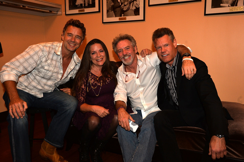 . NASHVILLE, TN - JUNE 05:  (L-R) John Schneider, Carlene Carter, Larry Gatlin and Randy Travis attend the Johnny Cash Limited-Edition Forever Stamp launch at Ryman Auditorium on June 5, 2013 in Nashville, Tennessee.  (Photo by Rick Diamond/Getty Images)