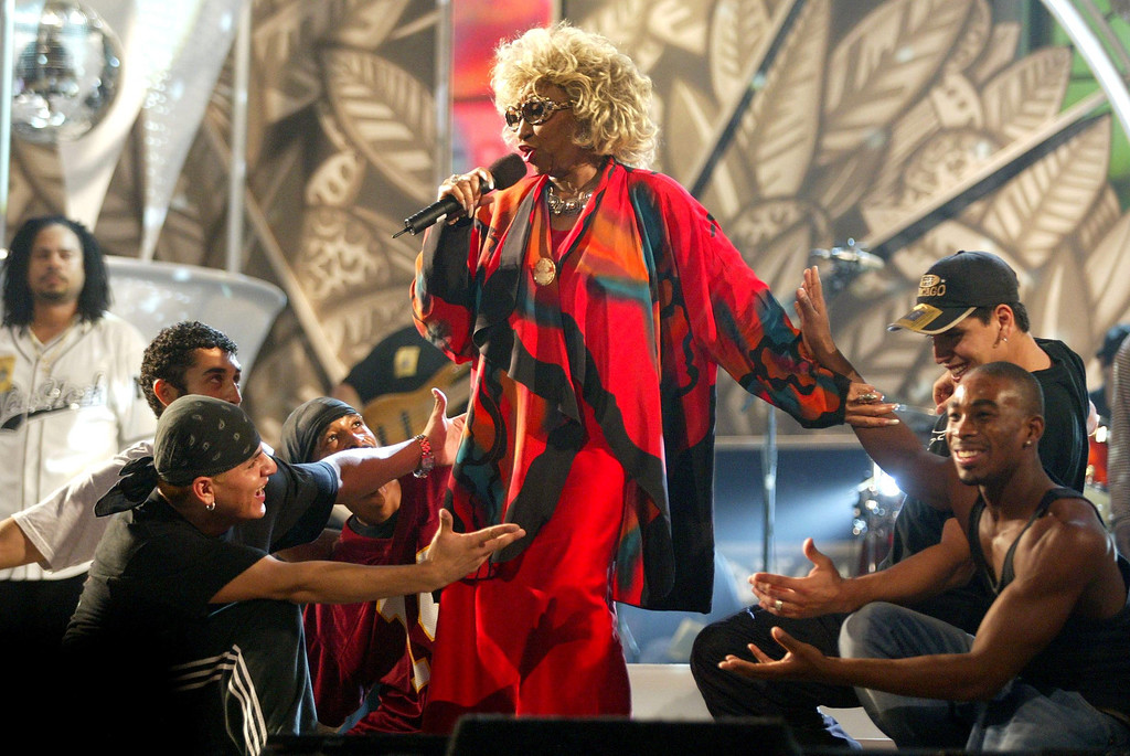 . LOS ANGELES, UNITED STATES:  Cuban singer Celia Cruz (C) performs during rehearsals for the 3rd annual Latin Grammy awards, at the Kodak Theatre in Hollywood, CA, 16 September 2002.    ( STEWART COOK/AFP/Getty Images)