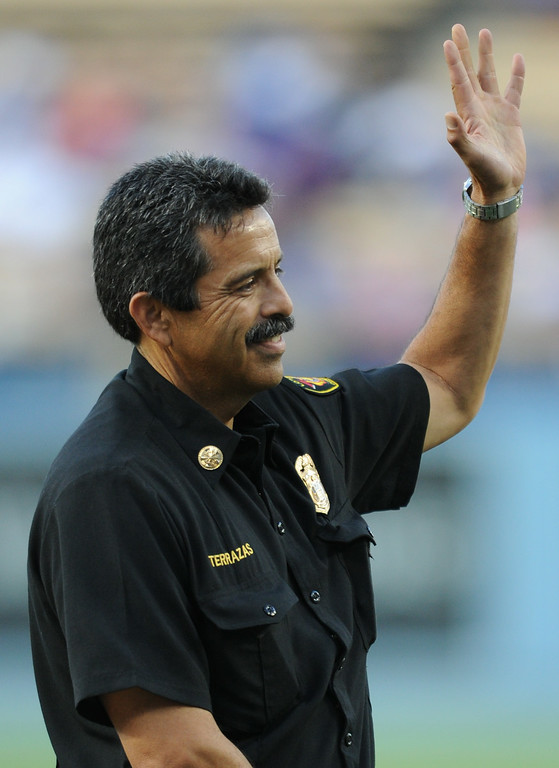 . Newly installed LAFD Chief Ralph Terrazas waves to the crowd before he throws out the first pitch at Dodger Stadium, as the team hosts the San Diego Padres at the inaugural Firefighter Appreciation Night. Los Angeles, CA. 8/19/2014(Photo by John McCoy Daily News)