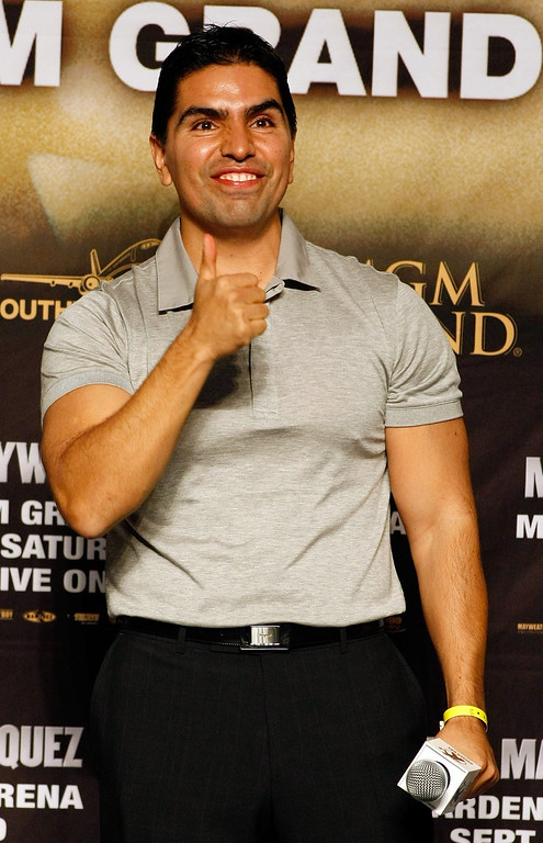 ". LAS VEGAS - SEPTEMBER 18:  Radio personality Eddie ""Piolin\"" Sotelo gestures during the official weigh-in for boxers Floyd Mayweather Jr. and Juan Manuel Marquez at the MGM Grand Garden Arena September 18, 2009 in Las Vegas, Nevada. The two will fight at the MGM on September 19.  (Photo by Ethan Miller/Getty Images)"