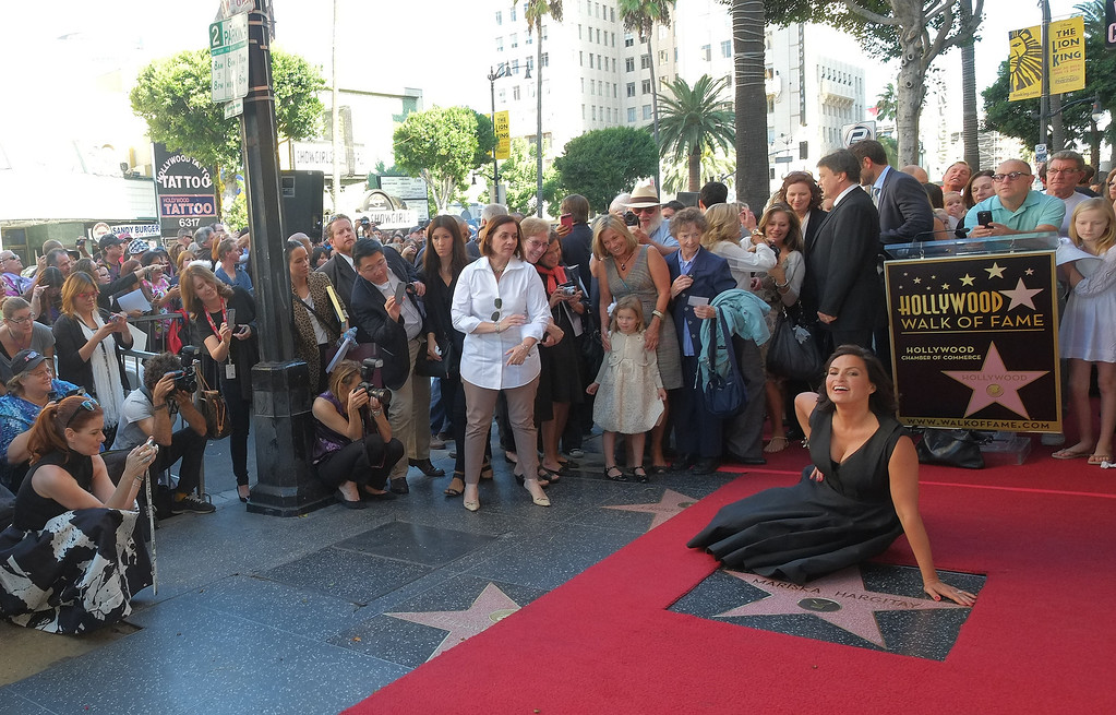 . Actress Mariska Hargitay poses as she is honored with a star on the Hollywood Walk of Fame on November 8, 2013 in Hollywood, California. The star was placed next to that of Hargitay\'s mother actress Jayne Mansfield.           (JOE KLAMAR/AFP/Getty Images)