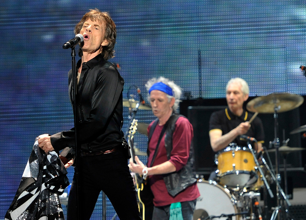 ". Mick Jagger, left, Keith Richards, center, and Charlie Watts of the Rolling Stones perform on the kick-off of the band\'s ""50 and Counting\"" tour at the Staples Center on Friday, May 3, 2013 in Los Angeles. (Photo by Chris Pizzello/Invision/AP)"