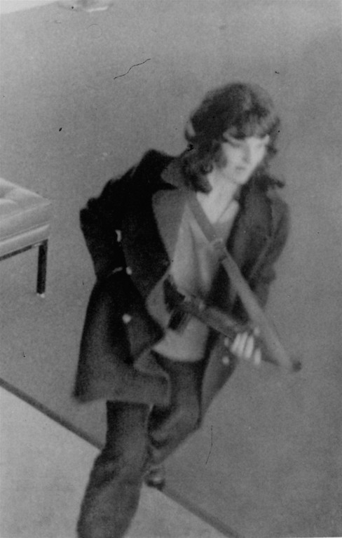 . A warrant has been issued for newspaper heiress Patricia Hearst who the FBI says is shown in this hidden camera photo taking part in a bank robbery in San Francisco, Monday, April 15, 1974.  Three women previously linked with the terrorist Symbionese Liberation Army were also identified from hidden camera photos.  Authorities said Miss Hearst may have been forced into taking part in the robbery. (AP Photo)