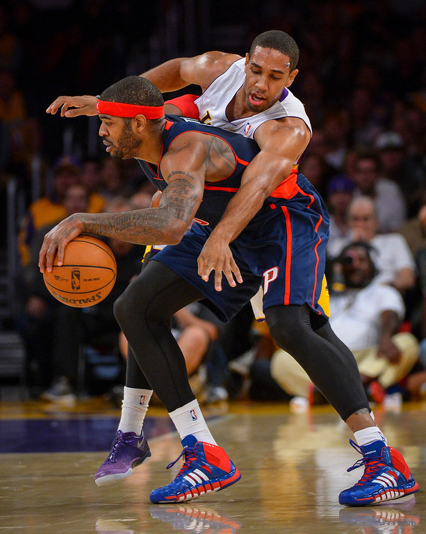 . Lakers� Xavier Henry tries to get the ball from Detroit�s Josh Smith during first half action at Staples Center Sunday, November 17, 2013.  ( Photo by David Crane/Los Angeles Daily News )