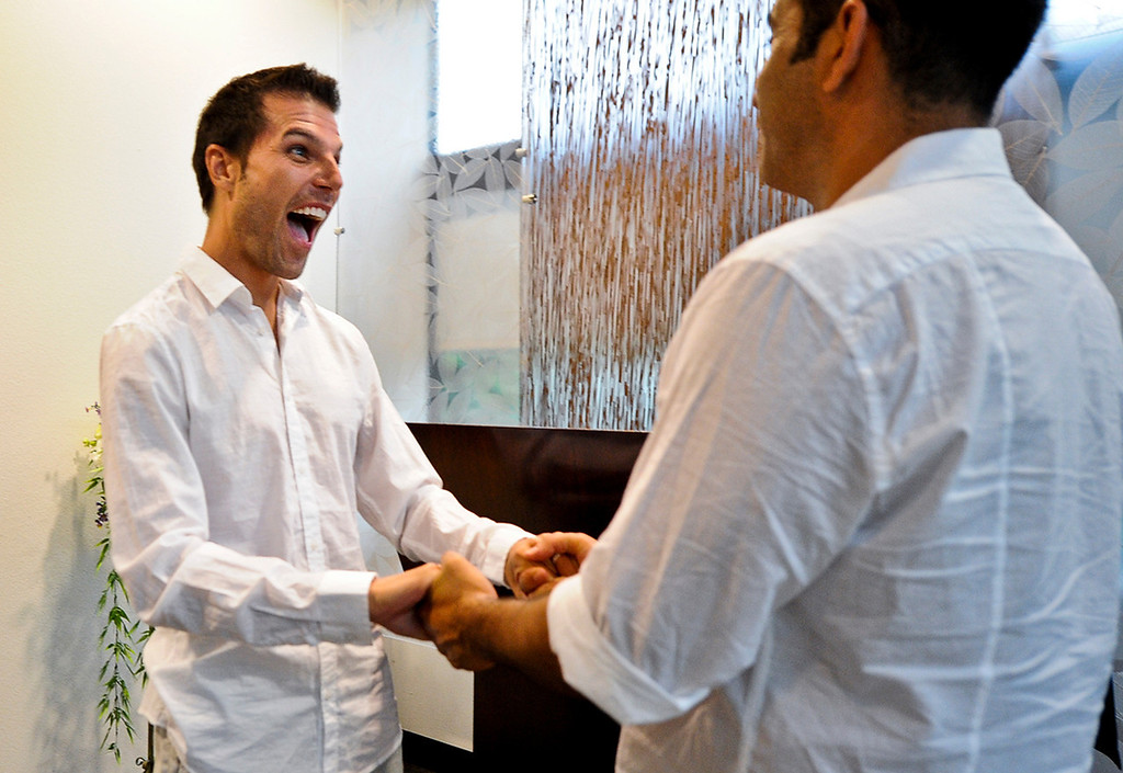 . Christopher Persky, 32, left, and his partner of 10 years Ken Bencomo, 45, both of Rancho Cucamonga, celebrate as they get married at the San Bernardino County Hall of Records in San Bernardino on Monday, July 1, 2013. (Rachel Luna / Staff Photographer)