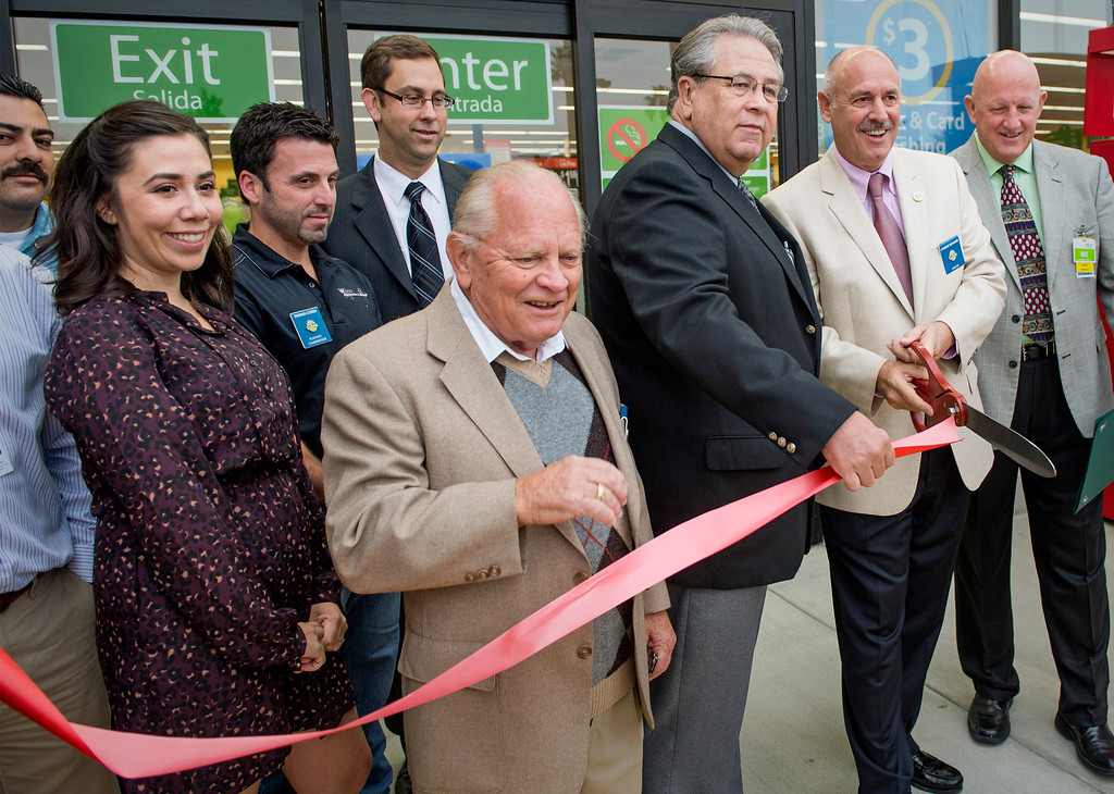 . Walmart staff and La Puente officials cut the ribbon during the grand opening of Walmart Neighborhood Market at 1425 N. Hacienda Boulevard in La Puente, Calif. October 2, 2013.  (Staff photo by Leo Jarzomb/SGV Tribune)
