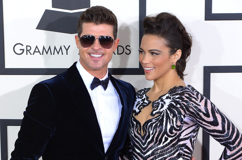 . Robin Thicke and Paula Patton arrive at the 56th Annual GRAMMY Awards at Staples Center in Los Angeles, California on Sunday January 26, 2014 (Photo by David Crane / Los Angeles Daily News)