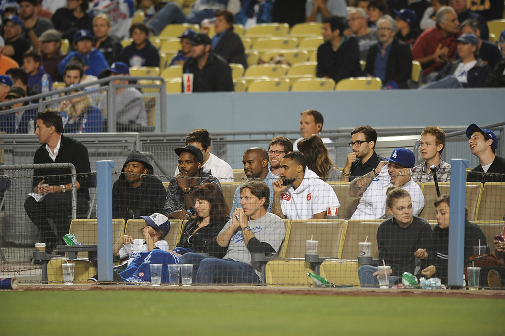 . In this handout photo provided by the Los Angeles Dodgers, Kanye West and Rob Kardashian attend the New York Mets v Los Angeles Dodgers game at Dodger Stadium on August 14, 2013 in Los Angeles, California. (Photo by Juan Ocampo/Los Angeles Dodgers via Getty Images)