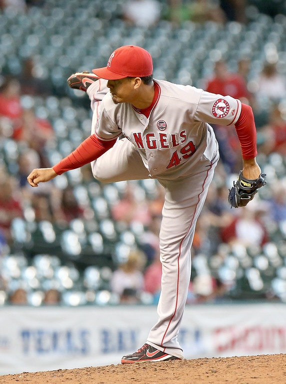 . HOUSTON, TX - SEPTEMBER 15: Ernesto Frieri #49 of the Los Angeles Angels of Anaheim pitches against the Houston Astros in the eighth inning on September 15, 2013 at Minute Maid Park in Houston, Texas. (Photo by Thomas B. Shea/Getty Images)