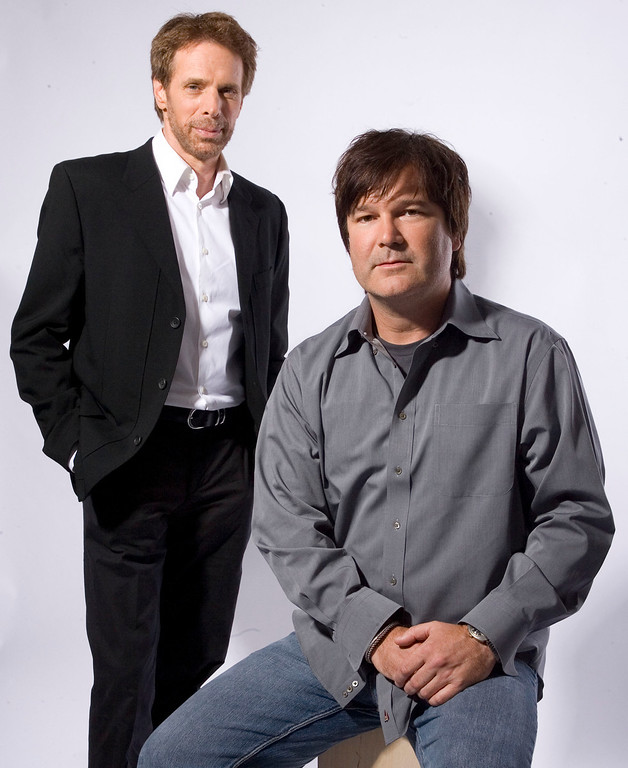 """. Producer Jerry Bruckheimer, left, and director Gore Verbinski pose in Beverly Hills, Calif., on Thursday, June 22, 2006.  If making a movie is a gamble, making two movies at once doubles the ante. That\'s what Bruckheimer and Verbinski did when they signed on to make two \""""Pirates of the Caribbean\"""" movies at the same time. (AP Photo/Matt Sayles)"""
