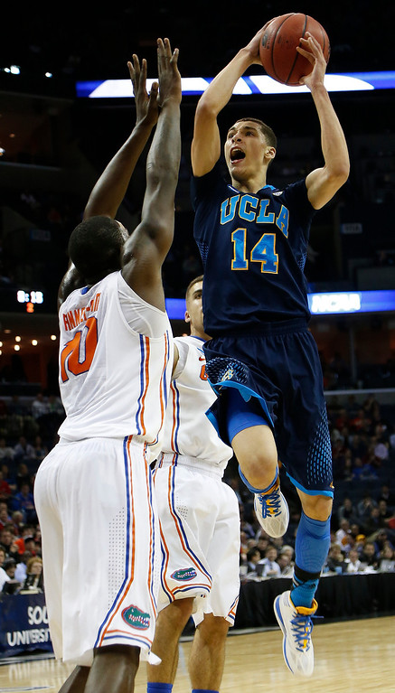 . UCLA guard Zach LaVine (14) shoots against Florida forward Dorian Finney-Smith (10) during the second half in a regional semifinal game at the NCAA college basketball tournament, Thursday, March 27, 2014, in Memphis, Tenn. (AP Photo/Mark Humphrey)