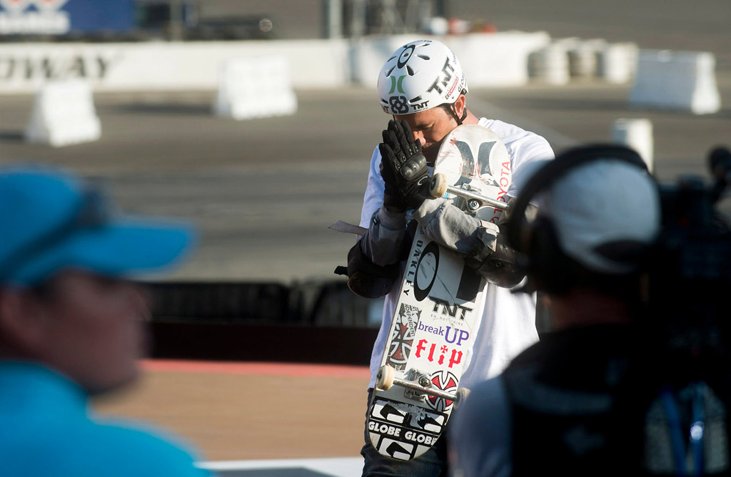 . Bob Burnquist prays before he competes in the America\'s Navy Skateboard Big Air final during X Games Los Angeles at Irwindale Event Center in Irwindale on Thursday, August 1, 2013. (SGVN/Staff photo by Watchara Phomicinda)