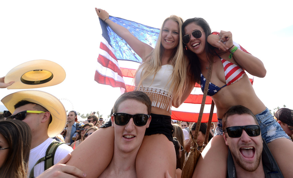 . McKencie Fagan, 20, and Max Ankeney, 21, both from San Diego, and Alyssa Smith, 20, from Dixie, and Chris O\'Conner, 23, from Auburn, enjoy the opening day of Stagecoach 2014 Friday April 25, 2014 at the Empire Polo Club in Indio. (Will Lester/Inland Valley Daily Bulletin)