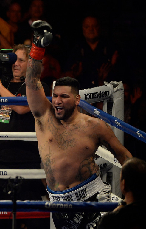 . (IN WHT TNKS) Heavy weight boxer Chris Arreola goes 1 round with Seth Mitchell Saturday Sept 7th. at the Fantasy Springs  Resort Casino. Chris Arreola  took the win for the WBC International  heavyweight title by TKO as referee Jack Reese stop the fight near the end of the 1st round as Seth Mitchell was not fighting back.  Indio CA. Photo by Gene Blevins/LA Daily News