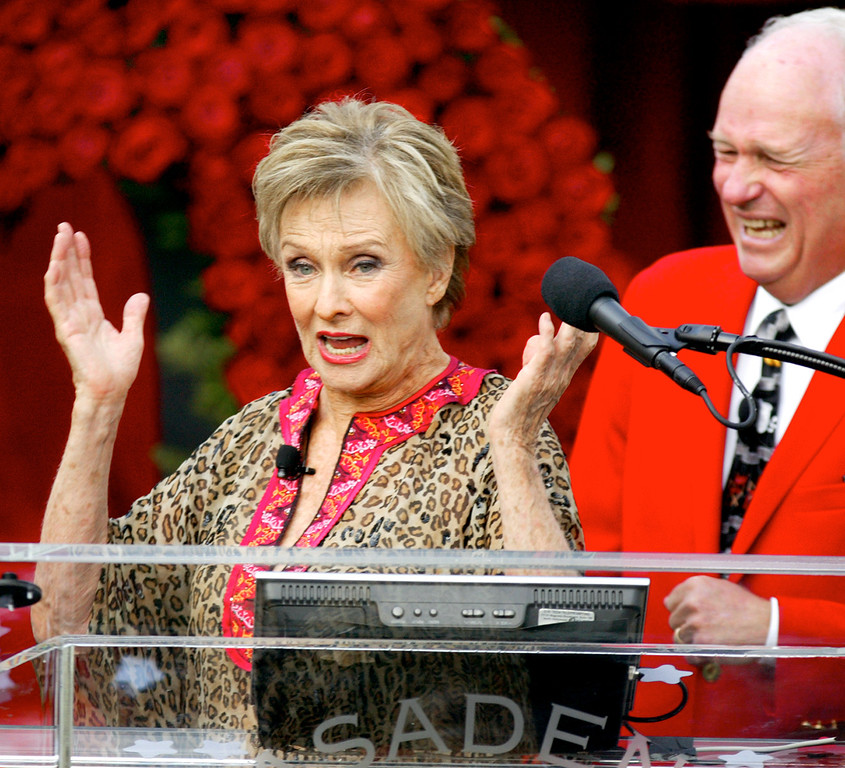 ". Cloris Leachman having fun speaking at the podium after being announced as Grand Marshal by Tournament President Ronald Conzonire right, of  the Tournament of Roses Friday, October 10, 2008.  Renowned television and cinema actress, Cloris Leachman, will serve as the Grand Marshal for the 2009 Tournament of Roses festivities.  ""Themed Hats Off to Entertainment\"", the 2009 Rose Parade will pay tribute to the many genres of entertainment that thrill audiences young and old. (SGVN/Staff Photo by Walt Mancini/Pasadena Star News)"
