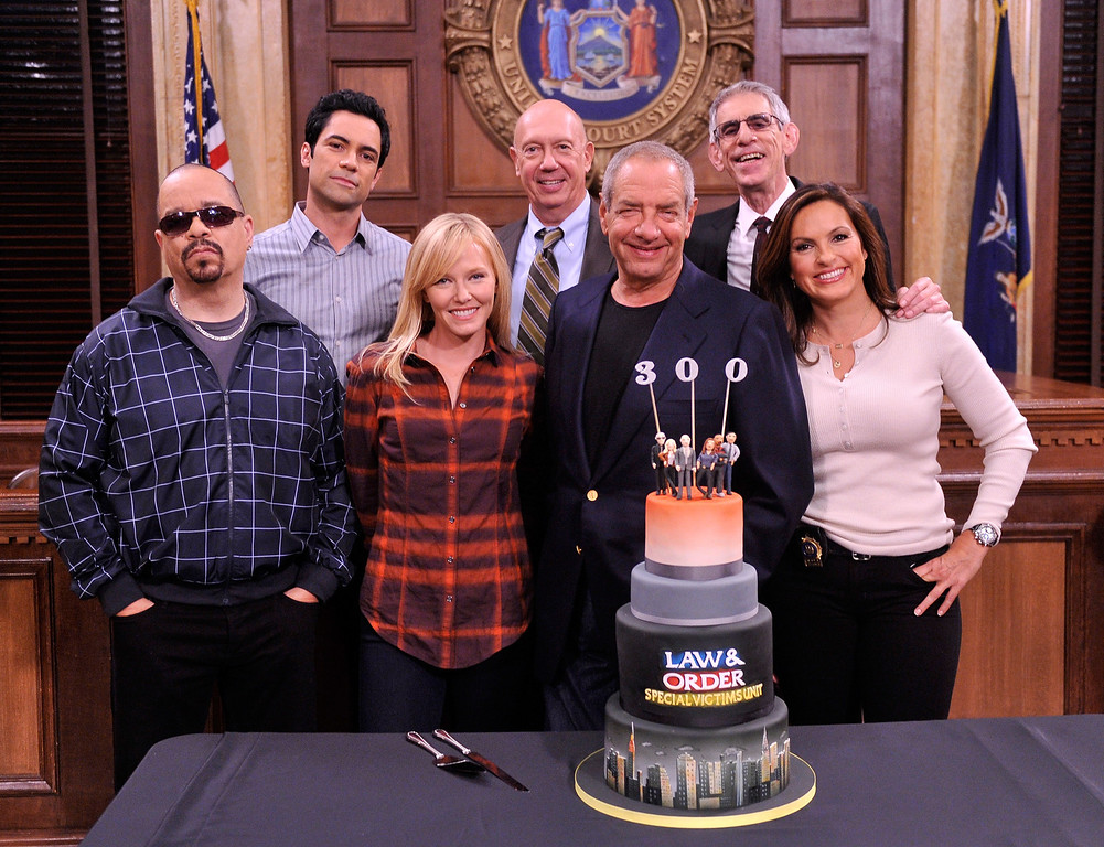 ". NEW YORK, NY - SEPTEMBER 17:  (L-R)  Actor/rapper Ice-T, actor Danny Pino, actress Kelli Giddish, actor Dan Florek, creator/executive producer Dick Wolf, actor Richard Belzer, and actress Mariska Hargitay pose for a photo at the ""Law And Order: SVU\"" 300 Episodes Celebration at Chelsea Piers on September 17, 2012 in New York City.  (Photo by Stephen Lovekin/Getty Images)"