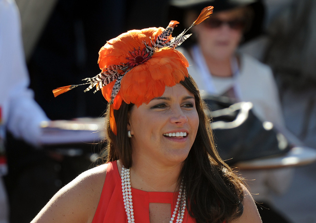 . Race fan wearing colorful hats look on during the seventh race during the Breeders\' Cup at Santa Anita Park in Arcadia, Calif., on Saturday, Nov. 2, 2013.    (Keith Birmingham Pasadena Star-News)