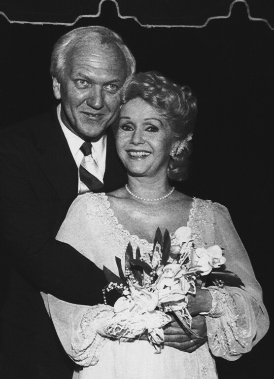 . Actress Debbie Reynolds poses with husband Richard Hamlet after the couple were married in a private ceremony, May 26, 1984 in Miami Beach.  Reynolds, 52, met the Virginia real estate developer at Harrah\'s. It is the third marriage for Miss Reynolds and the second for Hamlett, according to a spokesperson for Reynolds. (AP Photo)