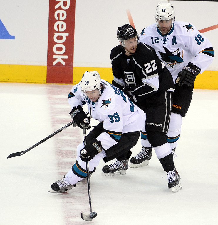 . San Jose Sharks center Logan Couture (39) controls the puck past Los Angeles Kings center Trevor Lewis (22) and teammate center Patrick Marleau (12) during the third period in Game 4 of an NHL hockey first-round playoff series at Staples Center in Los Angeles on Thursday, April, 24  2014. Los Angeles Kings won 6-3. (Keith Birmingham Pasadena Star-News)