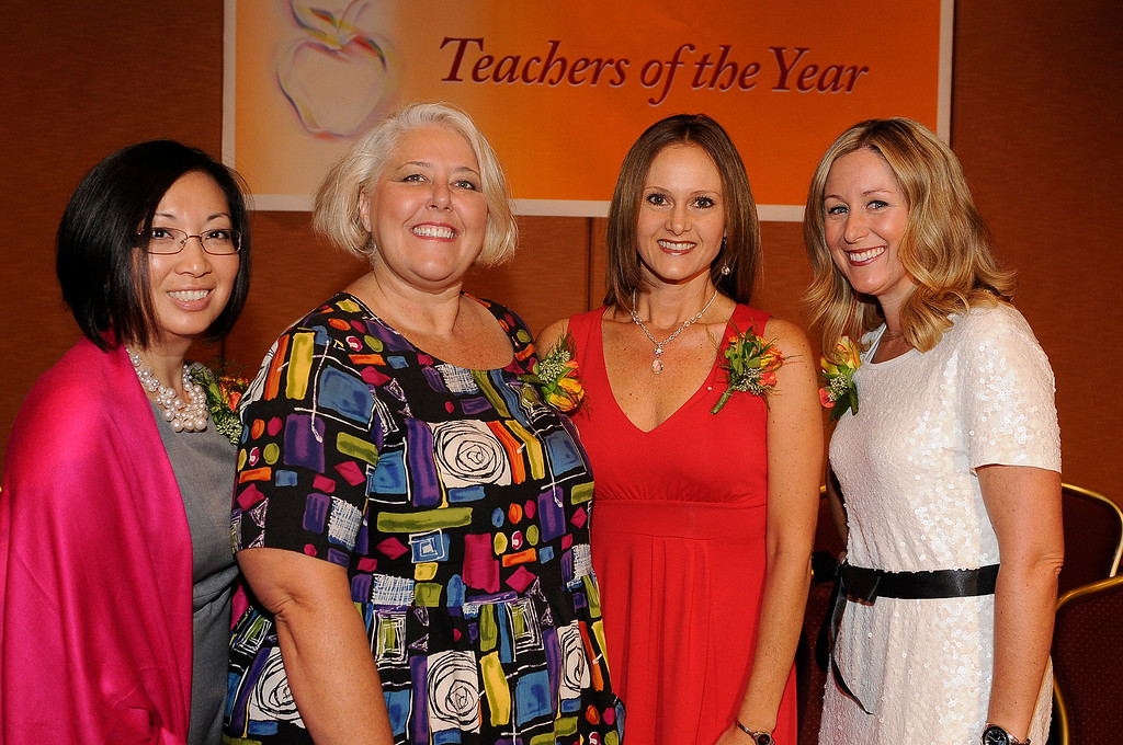 . (l-r) Joyce Taylor from Paramount USD, Kelly Baker Norwalk La Mirada USD, Jennifer Toledo from Downey USD and Kimberly Dueñas from Long Beach USD. Sixteen teachers from throughout the Los Angeles County were named as Teachers of the Year during a ceremony at the Universal Hilton. Teachers received a cash award from the California Credit Union as well as software and hardware to use in their classrooms from eInstruction. Universal City, CA. 9/27/2013. photo by (John McCoy/Los Angeles Daily News)