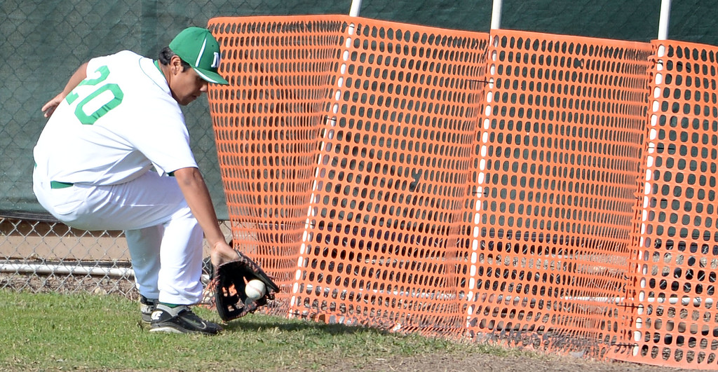 . Monrovia right fielder Eric Herrera fields a single by Alhambra\'s Jose Loera (not pictured) in the fourth inning of the Arcadia Elk Baseball Tournament at Monrovia High School in Monrovia, Calif., on Thursday, March 13, 2014. Monrovia won 2-0.  (Keith Birmingham Pasadena Star-News)