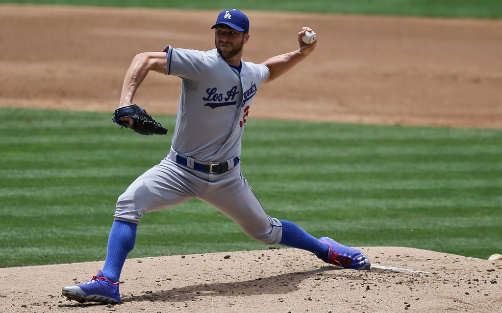 . Los Angeles Dodgers starting pitcher Chris Capuano works against the San Diego Padres in the second inning of a baseball game in San Diego, Sunday, June 23, 2013. (AP Photo/Lenny Ignelzi)