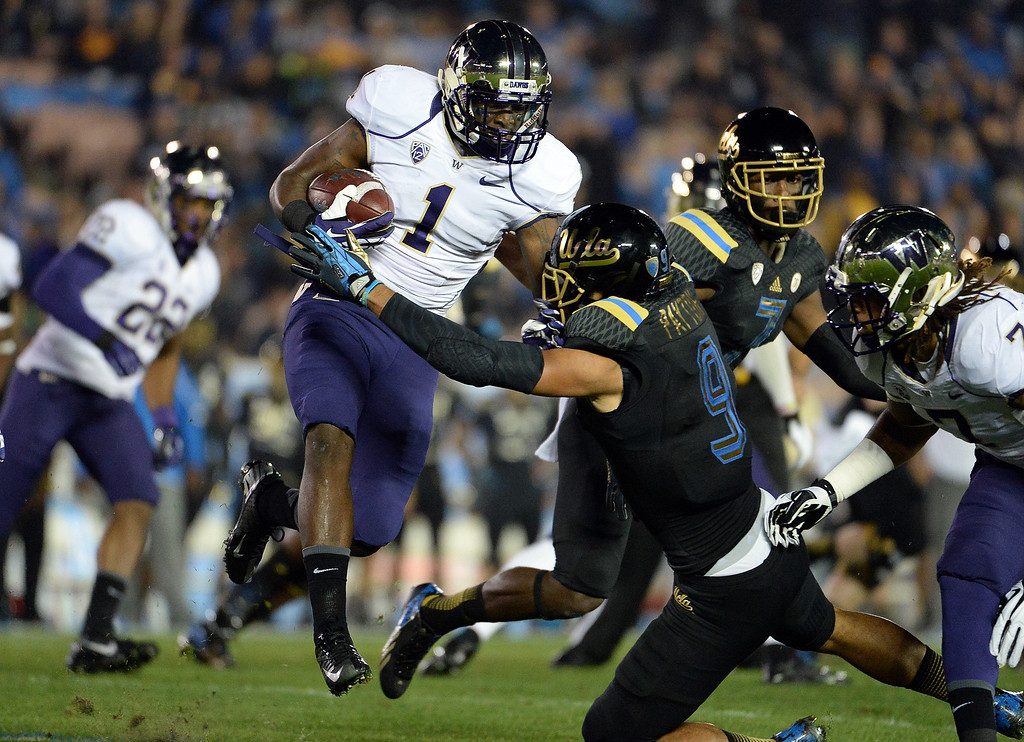 . Washington Huskies\'s John Ross (1) runs for a first down against UCLA Bruins during the first half of their college football game in the Rose Bowl in Pasadena, Calif., on Friday, Nov. 15, 2013.  UCLA won 41-31. 