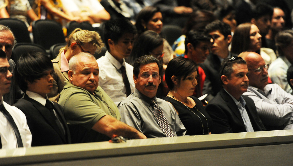 . Former cross-country coach James O\'Brien, center, as people speak on his behalf as over 200 people crowded the Arcadia Unified School District Performing Arts Center as a show of support for fired Arcadia High School cross-country coach James O\'Brien during a Arcadia Unified School District Board of Education meeting on Tuesday, July 23, 2013 in Arcadia, Calif. O\'Brien, led the team to two time state and national championships.