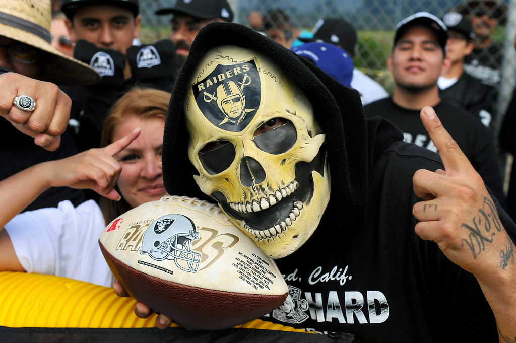 """. \""""Raider Ray\"""" wears a mask to the Cowboys-Raiders practice in Oxnard, Wednesday, August 13, 2014. (Photo by Michael Owen Baker/Los Angeles Daily News)"""