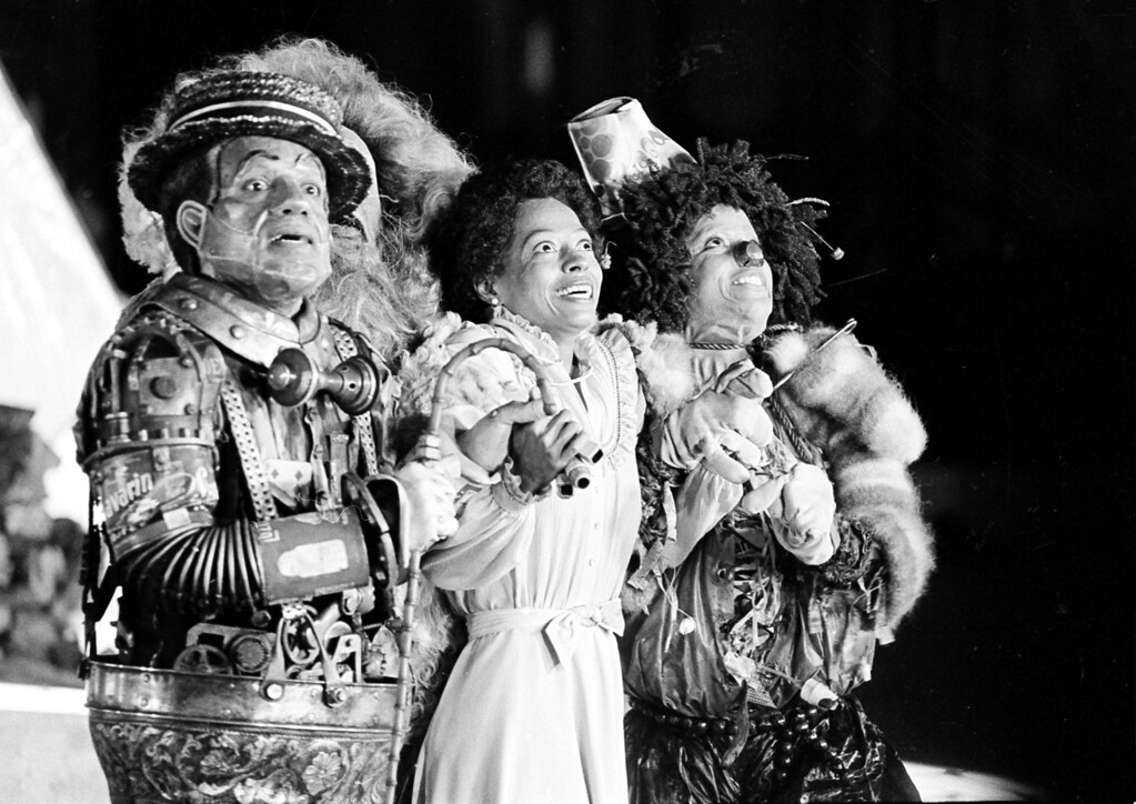 """. Diana Ross, center, as Dorothy, Michael Jackson, right, as Scarecrow, and Nipsey Russell as Tinman perform during filming of the musical \""""The Wiz\"""" in New York\'s World Trade Center, Tuesday, Oct. 4, 1977.  Ted Ross, portraying the Lion, is partly hidden behind Russell.  (AP Photo)"""