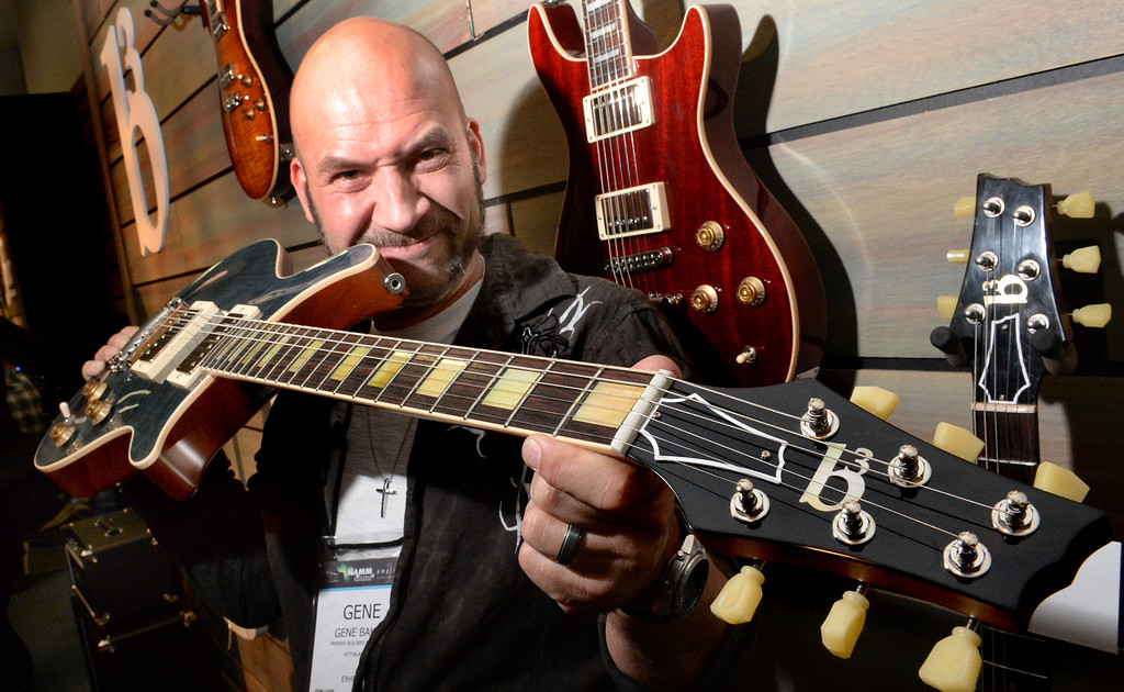 . Gene Baker, of Gene Baker Guitars, shows one of his custom built B3 guitars during The NAMM (National Association of Music Merchants) Show, the world wide music trade show, at the Anaheim Convention Center in Anaheim on Friday January 24, 2014. NAMM is a music trade show drawing retailers and other industry people to Anaheim for four days of everything music. (Staff Photo by Keith Durflinger/San Gabriel Valley Tribune)