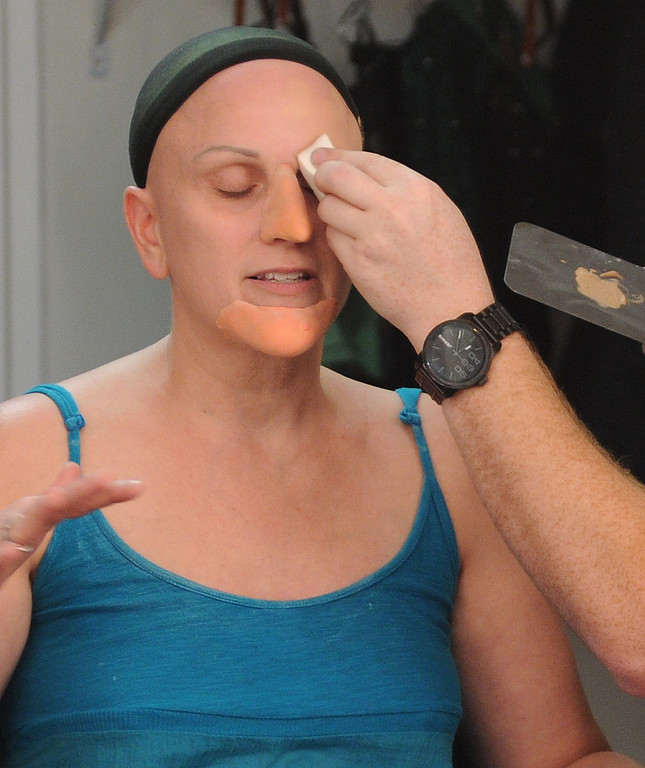 . The nose goes on after the chin. Jacquelyn Piro Donovan is transformed into the Wicked Witch by makeup artist Michael King. The Wizard of Oz is being staged at the Pantages Theatre in Hollywood, CA. 9/25/2013. photo by (John McCoy/Los Angeles Daily News)
