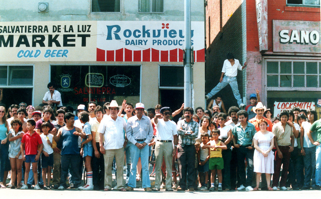 . Hollenbeck-area residents gather across the street from the police station where Richard Ramirez, the Night Stalker suspect, was taken after his arrest Saturday.  (Daily News file photo)