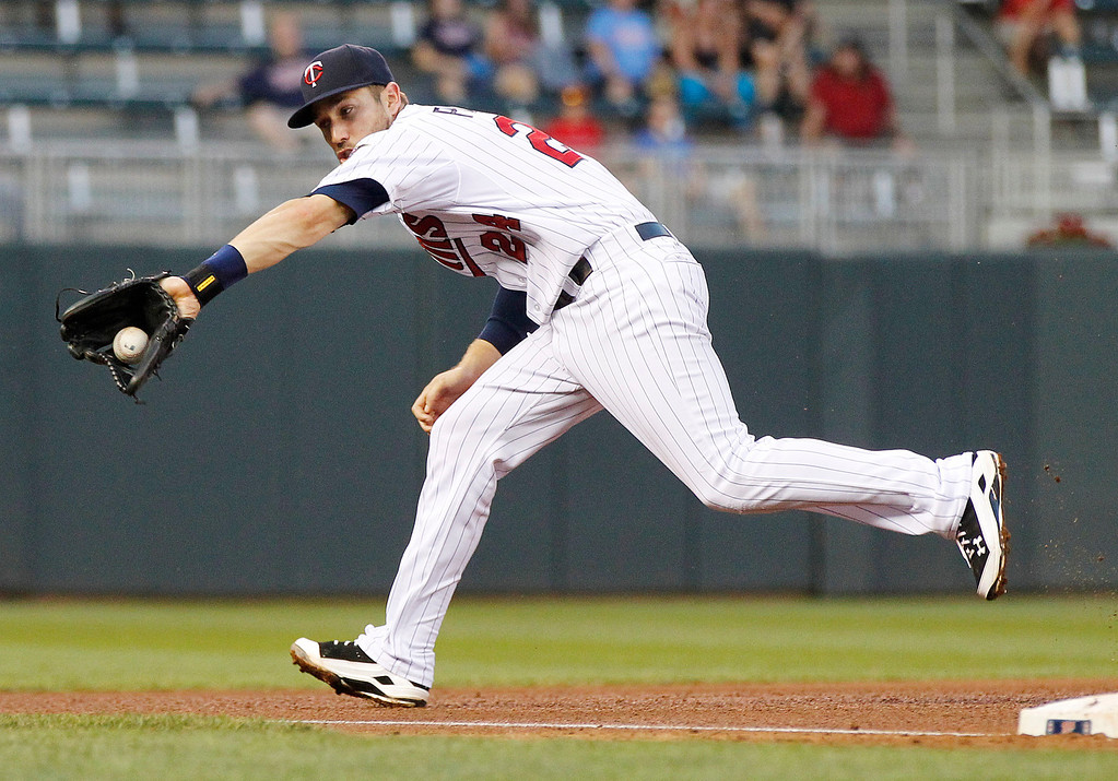 . Minnesota Twins third baseman Trevor Plouffe makes a play against the Los Angeles Angels in the fourth inning of their baseball game in Minneapolis Monday, Sept. 9, 2013.(AP Photo/Andy Clayton-King)