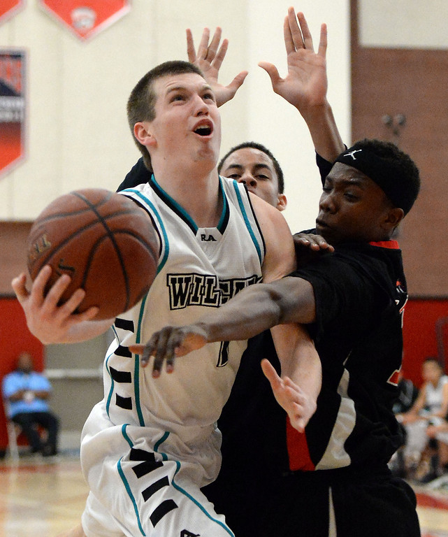 . Renaissance Academy \'s KJ Okmanas (C) (1) drives to the basket against View Park in the first half of a CIF Southern California Regional Division basketball game at Colony High School in Ontario, Calif., on Saturday, March 22, 2014.  (Keith Birmingham Pasadena Star-News)